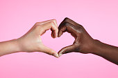 istock Diverse hands with love sign 1284052875