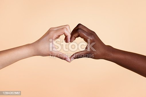 Diverse hands with love sign on beige background