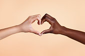 istock Diverse hands with love sign 1284052882