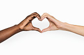 istock Diverse hands with love sign 936370078