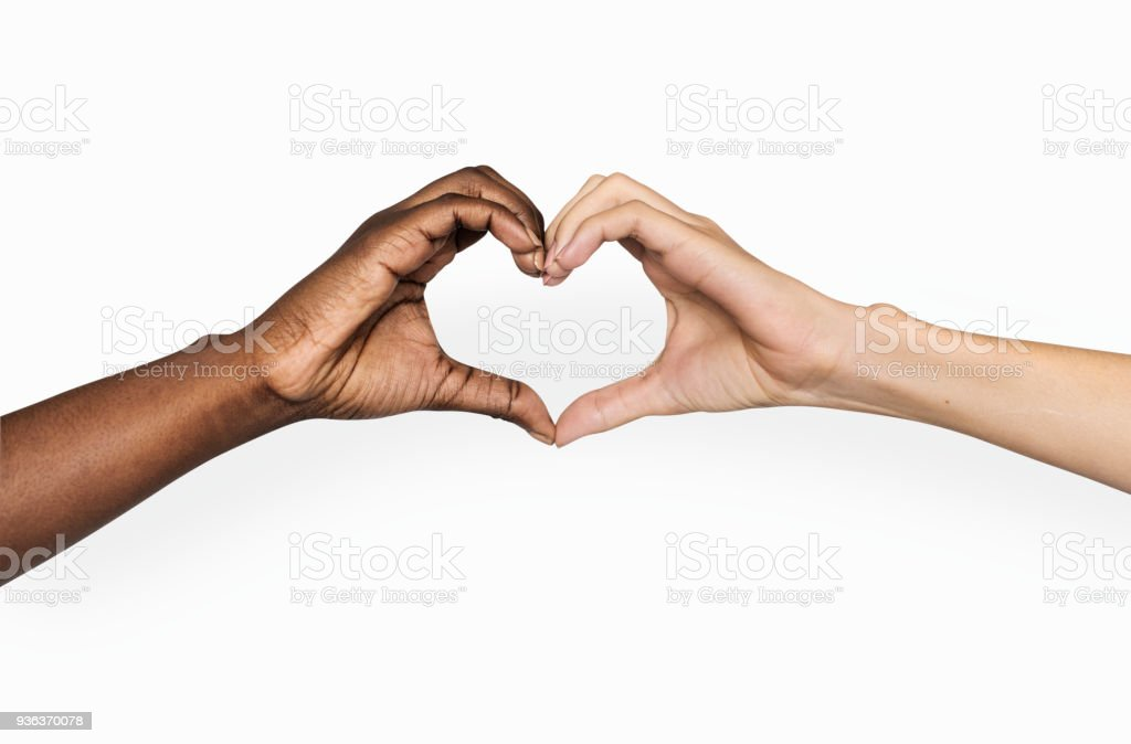 Diverse hands with love sign stock photo