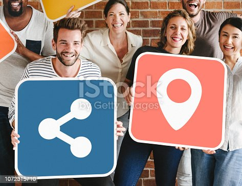 1094812112 istock photo Diverse happy people with social networking icons 1072315710