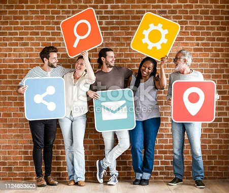 1094812112 istock photo Diverse happy people with social networking icons 1124653603