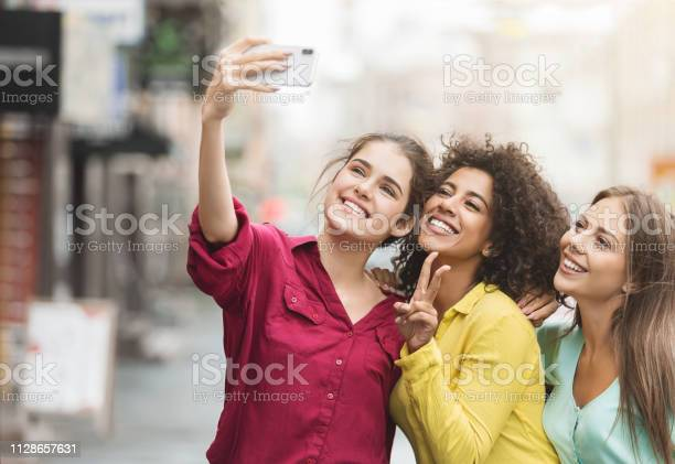 Diverse happy women walking in the city picture id1128657631?b=1&k=6&m=1128657631&s=612x612&h=ze0z irt0xp3hyespvnwmra73eespaevrlbzsjvgbyy=