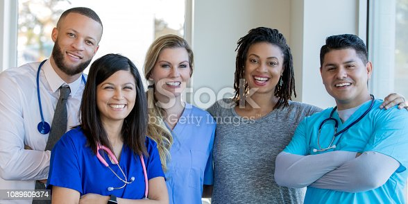 istock Diverse healthcare team of doctors and nurses standing in hospital hallway 1089609374