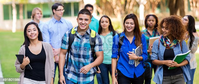 istock Diverse high school or college students walking on campus 491801586