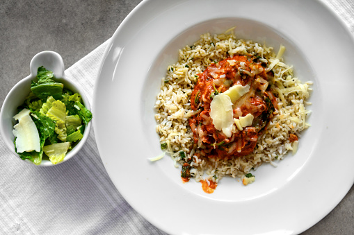 Keto cauliflower rice with tomato sauce and salad, Quebec, Canada