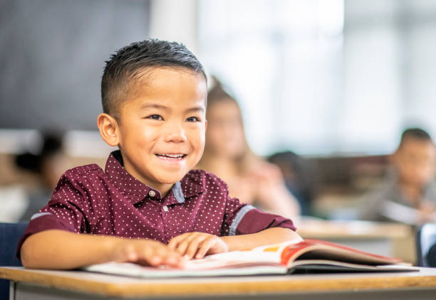 Diverse kids in a classroom Multi-ethnic group of school children. 6 7 years stock pictures, royalty-free photos & images