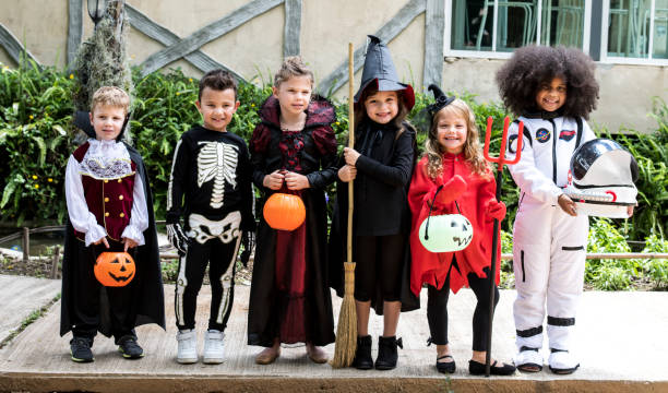 Diverse kids in Halloween costumes Diverse kids in Halloween costumes costume stock pictures, royalty-free photos & images