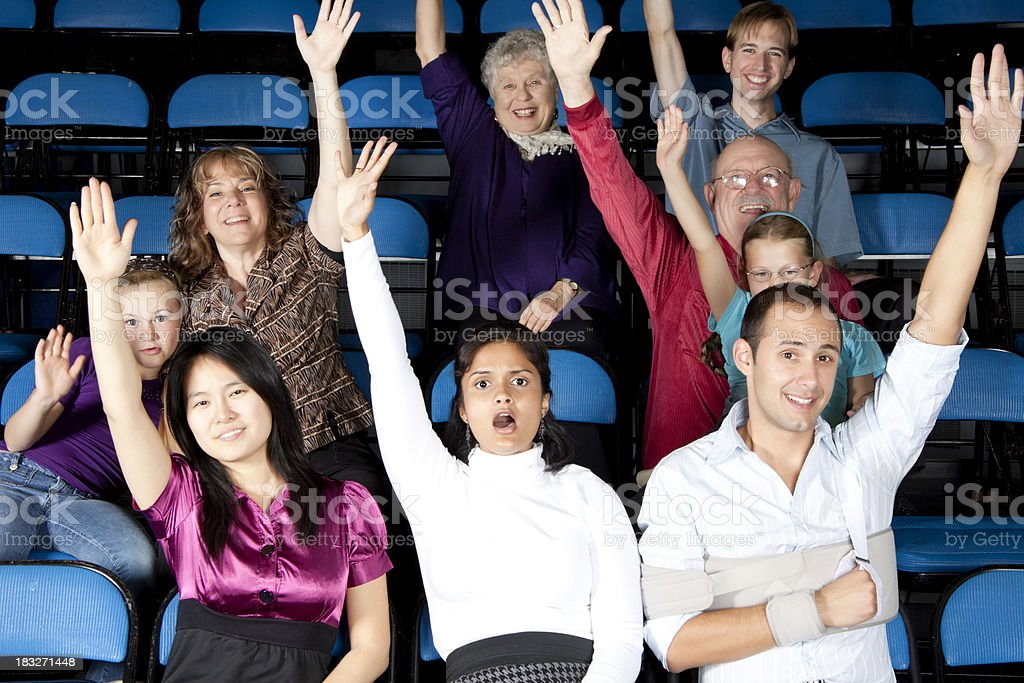 Diverse large group of people raising their hands royalty-free stock photo