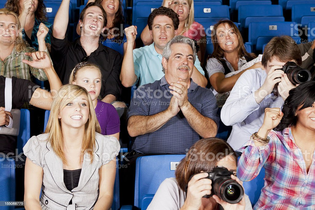 Diverse large group of people watching an exciting game royalty-free stock photo