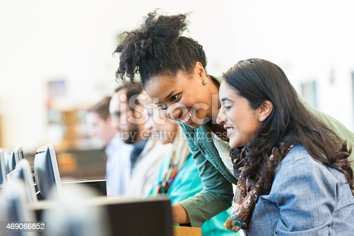 istock Diverse mid adult students using computers during class in college 469066852