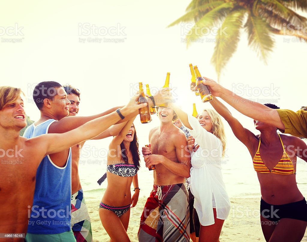 Diverse Multiethnic People Partying and Toasting Glasses stock photo