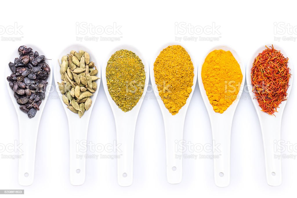 Diverse of spices in ceramic spoon isolated on white background stock photo