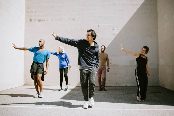 diverse outdoor multigenerational dance class group - dance group stock photos and pictures