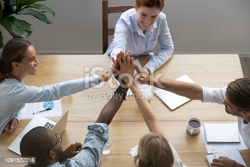 istock Diverse partners feels happy reached business goal giving high five 1091527016