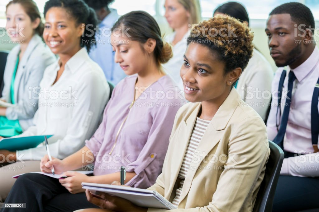 Diverse people attend continuing education class stock photo