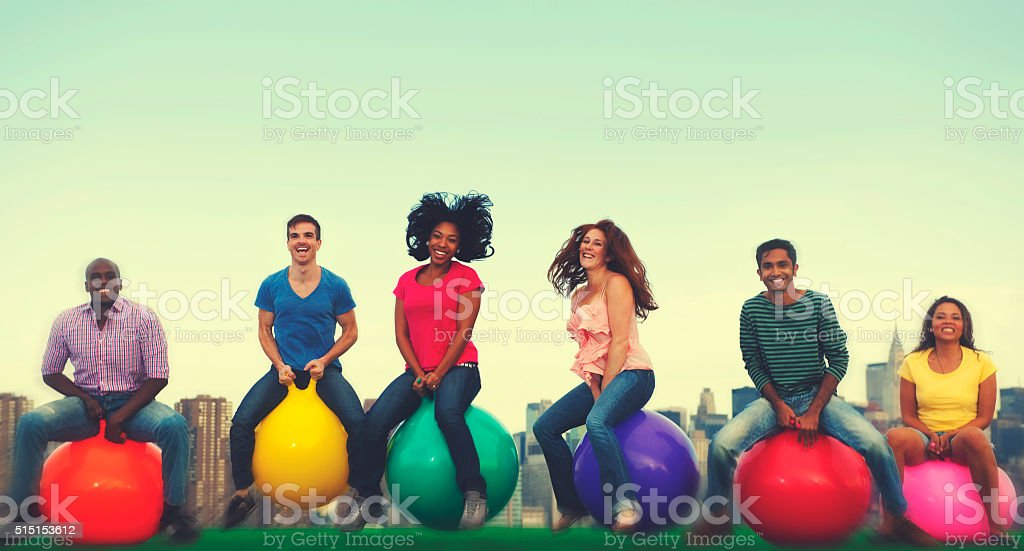 Diverse People Happiness Friendship Bouncing Ball Concept stock photo
