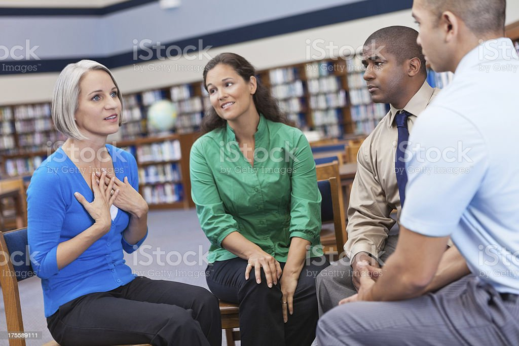 Diverse people having discussion in a group support meeting royalty-free stock photo