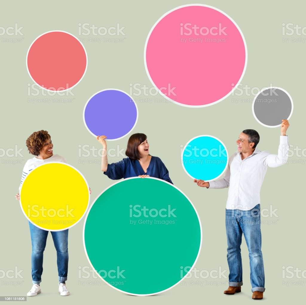 Diverse people holding colorful blank circles stock photo