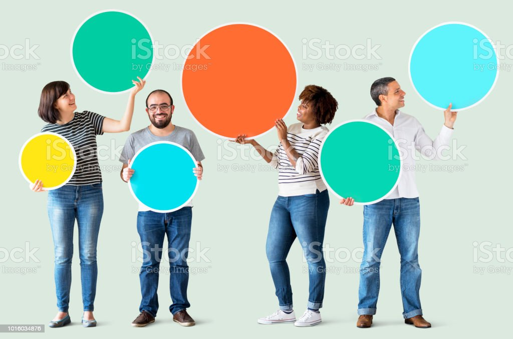 Diverse people holding colorful circles stock photo