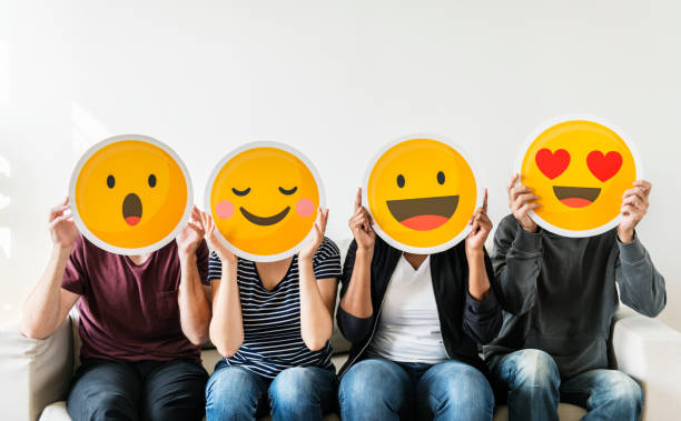diverse people holding emoticon - enjoyment stock pictures, royalty-free photos & images