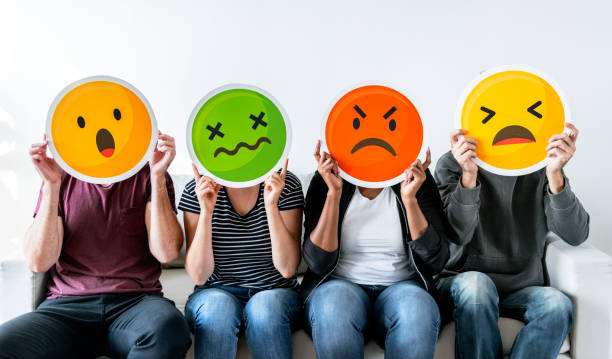 Diverse people holding emoticon Diverse people holding emoticon ***These graphics are derived from our own 3D generic designs. They do not infringe on any copyright design. a negative emotion stock pictures, royalty-free photos & images