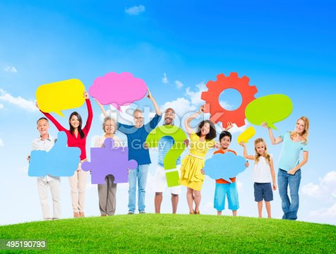 671270528istockphoto Diverse People Holding Symbols On a Hill 495190793