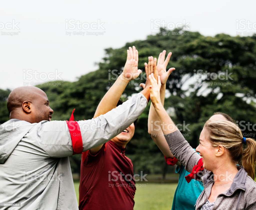 Diverse people making a high five - Royalty-free Achievement Stock Photo