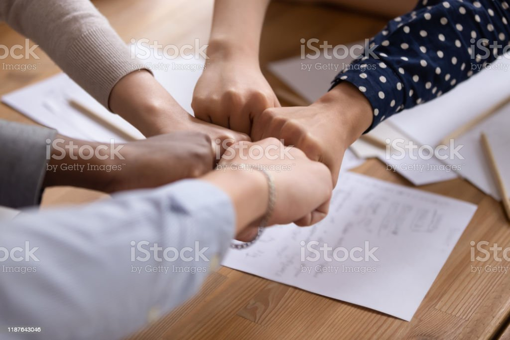 Diverse People Put Fists In Circle As Symbol Of Unity Stock Photo Download Image Now Istock