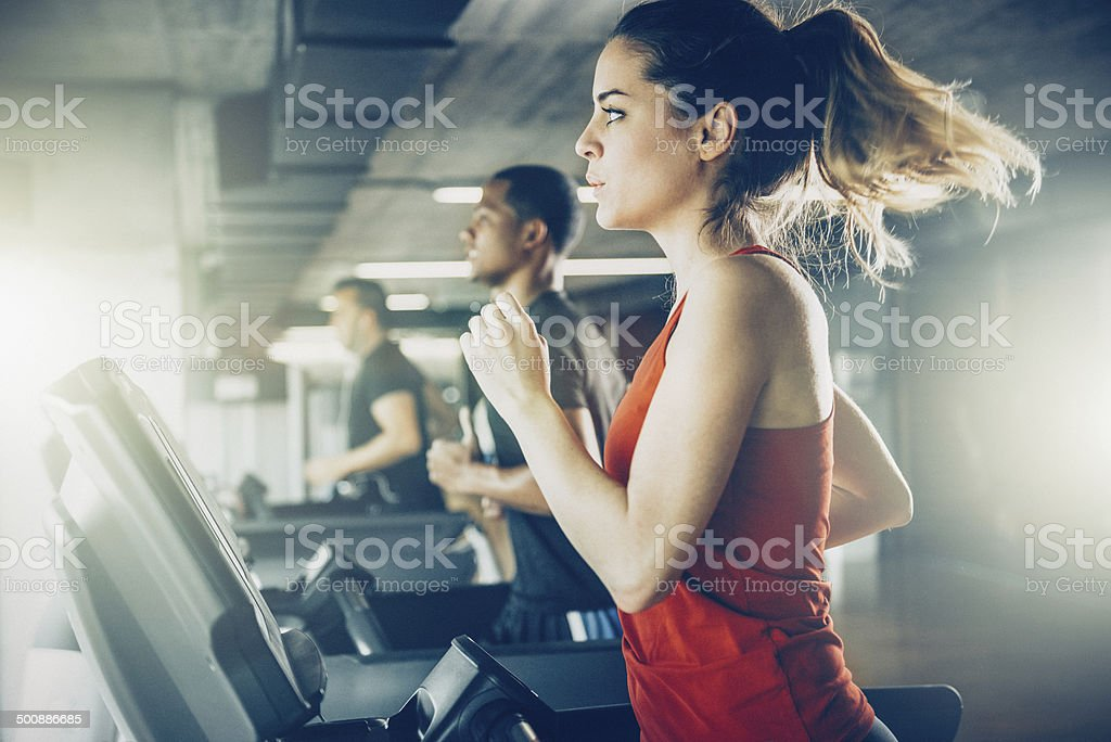 Diverse People Running on Treadmill stock photo