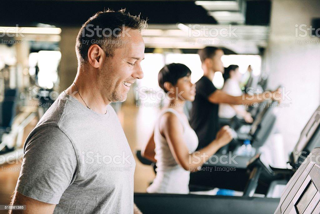 Diverse People Running on Treadmill stock photo