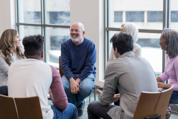 Diverse people sit in circle and brainstorm ideas stock photo
