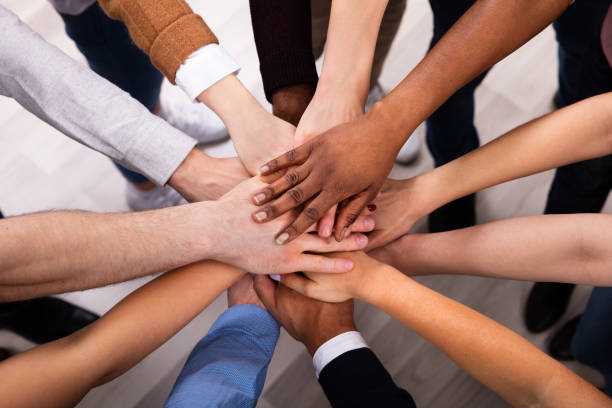 diverse people stacking hand together - together imagens e fotografias de stock