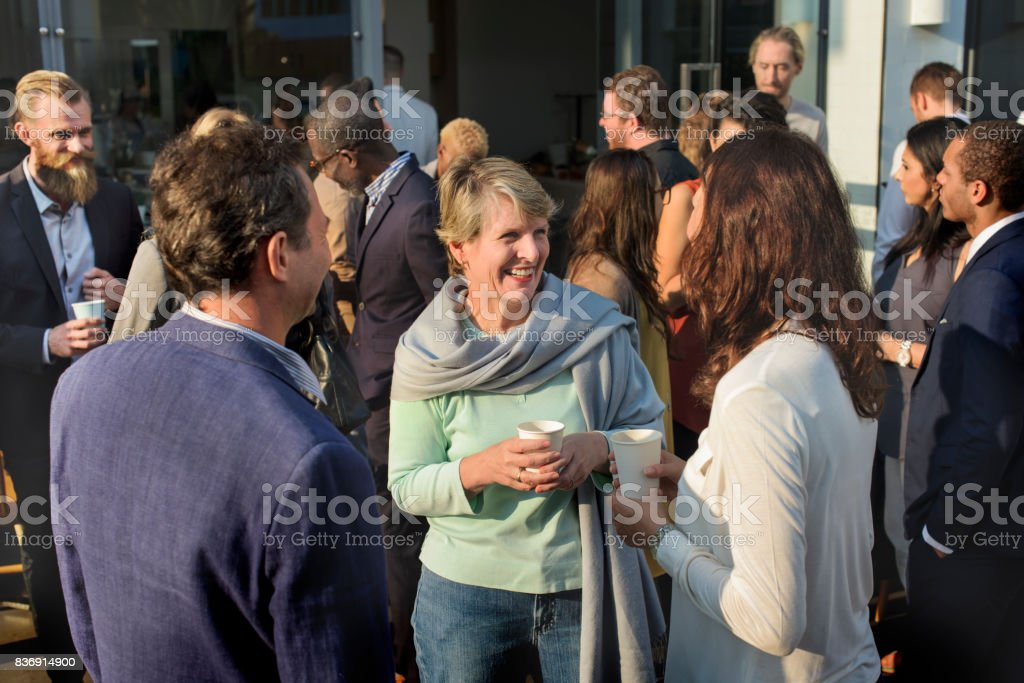 Diverse people standing talking outdoor stock photo