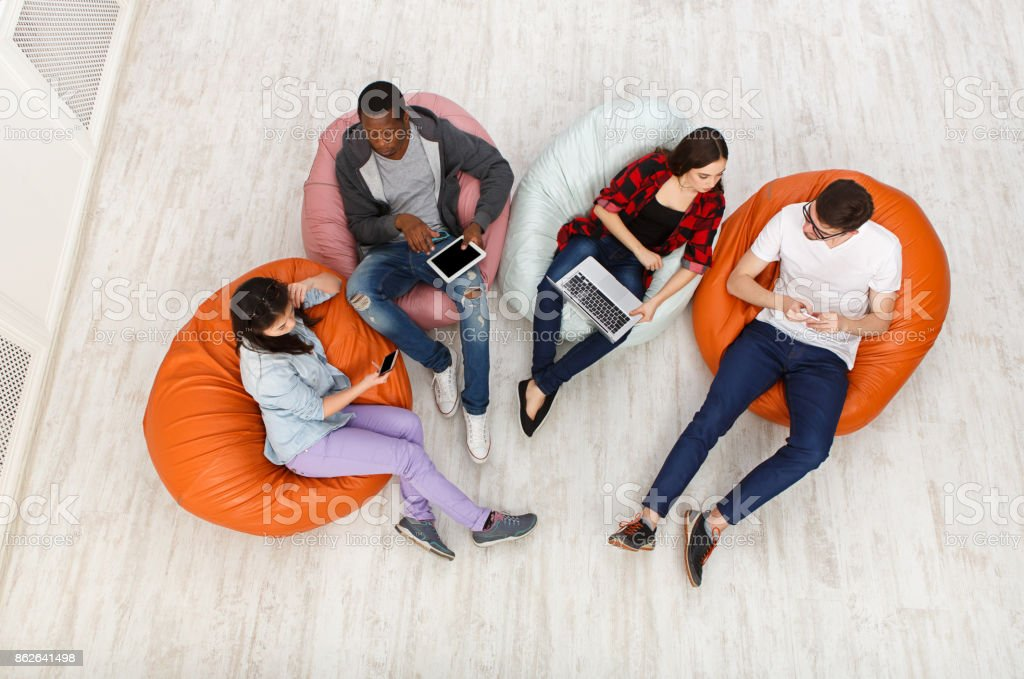 Diverse people using gadgets, top view stock photo