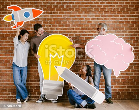 1094812112 istock photo Diverse people with creative idea icons 1073594778