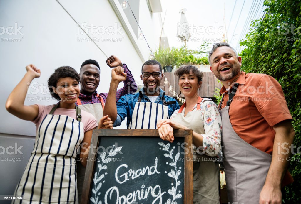 Diverse People with Grand Opening Sign First Day of Business stock photo