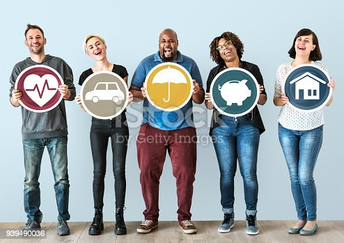 929887844 istock photo Diverse people with insurance protection plan 939490036