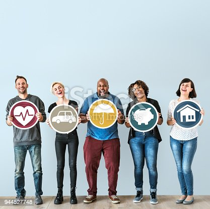 929887844 istock photo Diverse people with insurance protection plan 944527748