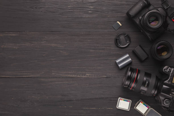 diverse personal equipment for photographer - camera photographic equipment stock photos and pictures