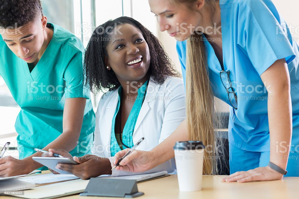 Diverse pre-med or nursing students study together stock photo