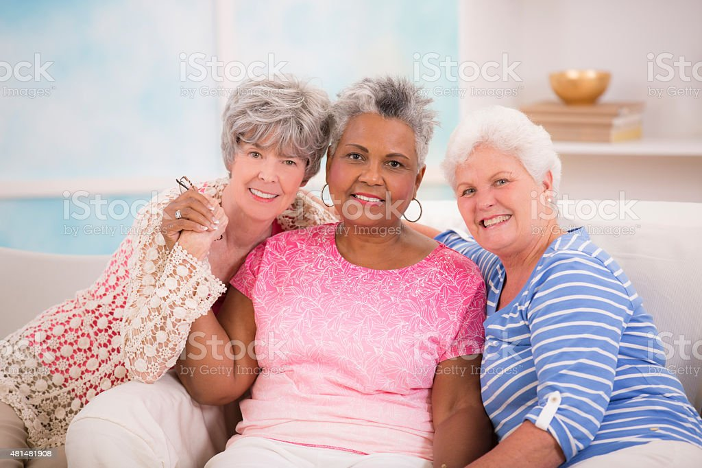 Diverse senior women friends share friendship. Assisted living or home. stock photo