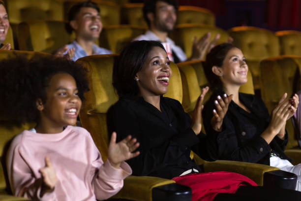 Diverse spectators applauding after show stock photo