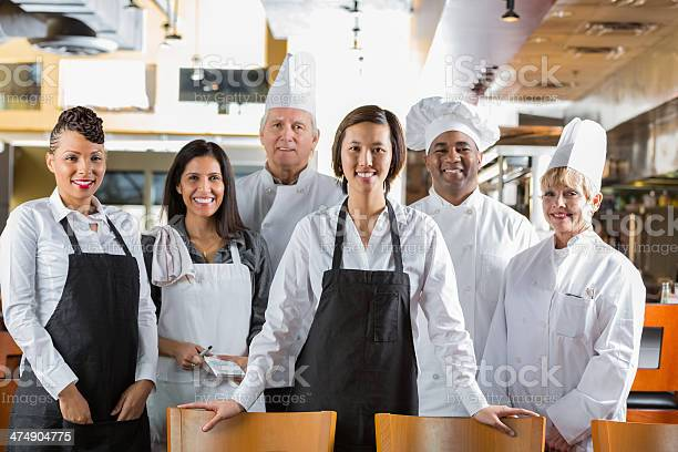 Diverse Staff Of Chefs And Waiters In Modern Restaurant Kitchen Stock Photo - Download Image Now