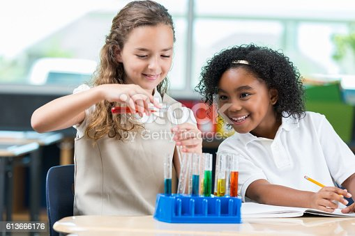 istock Diverse STEM school students work on science experiment 613666176