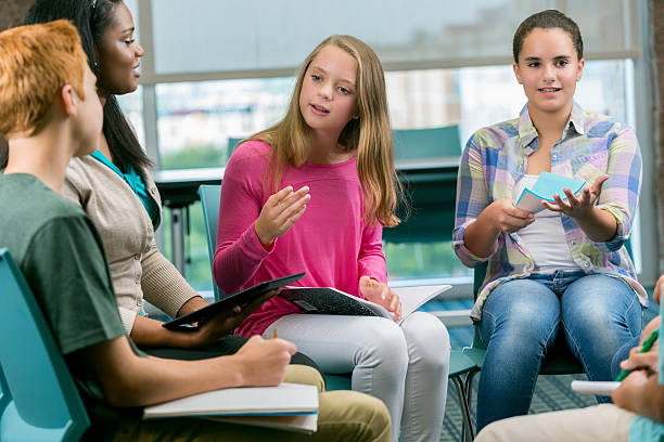 diverse students participate in group therapy - school counselor stock pictures, royalty-free photos & images