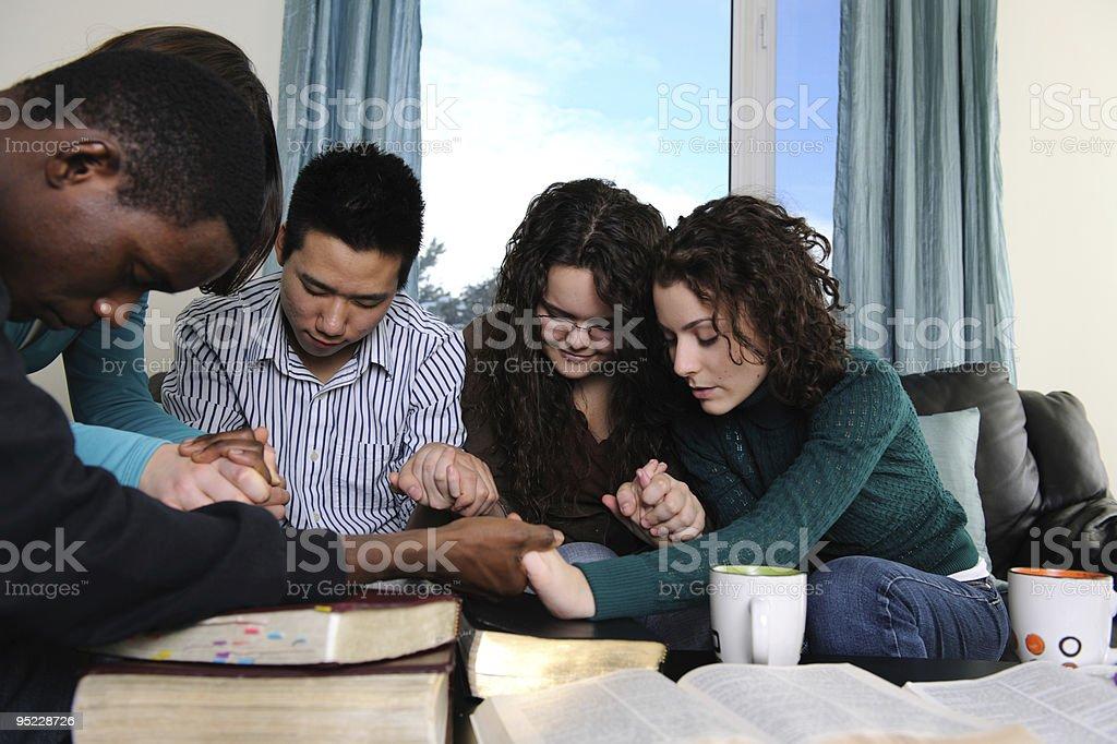 Diverse Students Praying royalty-free stock photo
