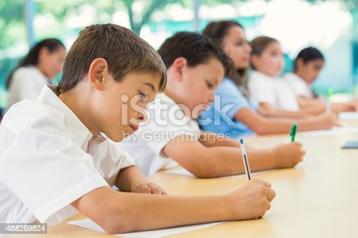 istock Diverse students taking test in private elementary school 488269824