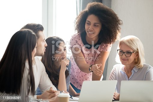 541975802 istock photo Diverse students workers team and mentor teacher involved in discussion 1135346391